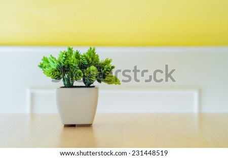 flowers pots decoration on wooden table - stock photo