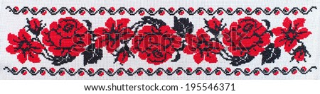 flowers roses and lillies embroidered cross-stitch pattern, ethnic ornament - stock photo