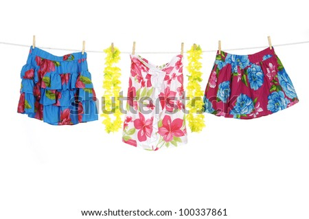 flowers skirt with lei on a clothespins on rope