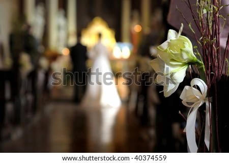 Flowers with a wedding ceremony in background - stock photo