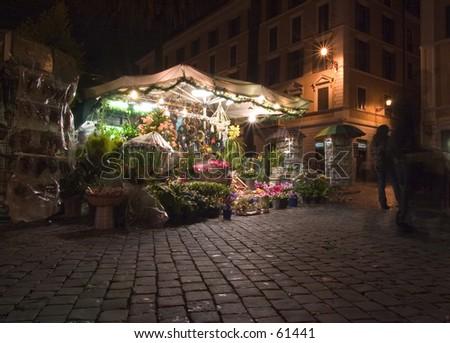 Flowershop at night, Rome December 2004 - stock photo
