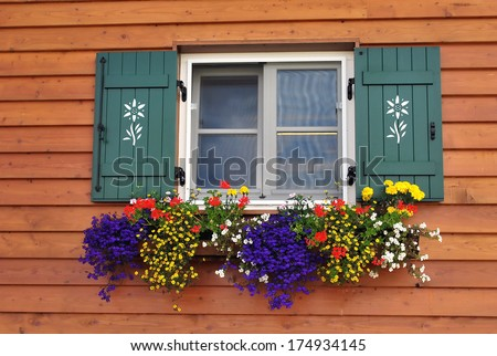 flowery balcony in a hut in val di funes, italy