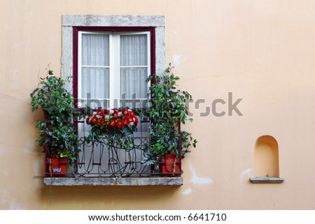 Flowery balcony in Alfama, a old neighborhood in Lisbon, Portugal. - stock photo