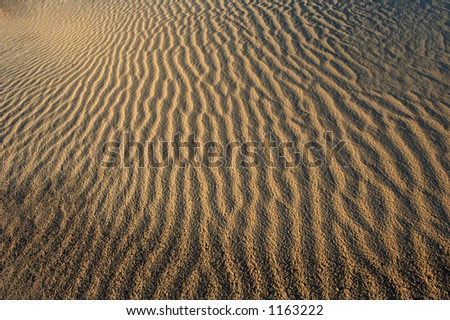 Flowing abstract patterns of sand. - stock photo