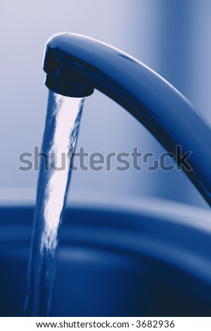 Flowing Fresh Tap Water. Shallow DOF. Focus on Tap. - stock photo