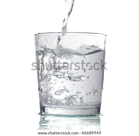 flowing liquid in a transparent glass - stock photo