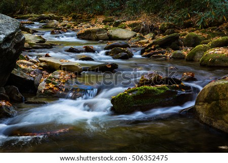 Flowing river in autumn with moss and fall leaves Smoky Mountains National Park Tennessee and North Carolina