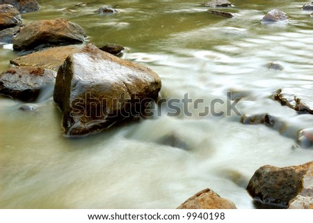 Flowing stream - stock photo
