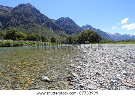 Flowing stream along the mountains - stock photo