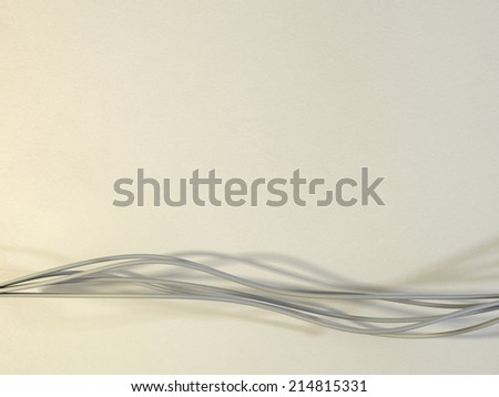 Flowing strings or ribbons on a warm textured background - stock photo