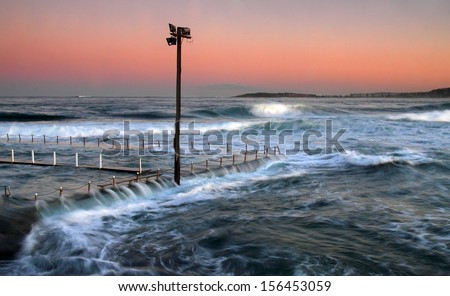 Flowing water over a tidal pool - stock photo