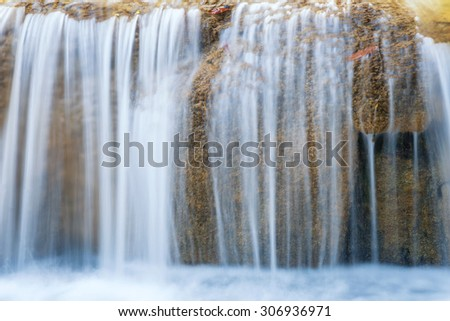 flowing waterfall by long exposure taking photography - stock photo