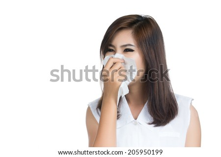 Flu cold or allergy symptom. Closeup of sick young woman girl ( Asian woman,Thai woman) with fever sneezing in tissue.allergies, the common cold, Health care.studio shot isolated on white background.