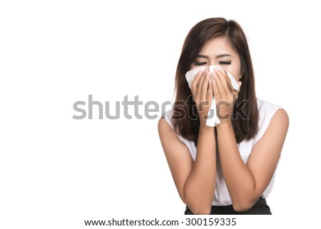 Flu cold or allergy symptom. Closeup of sick young woman girl ( Asian woman,Thai woman) with fever sneezing in tissue.allergies, the common cold, Health care.studio shot isolated on white background. - stock photo