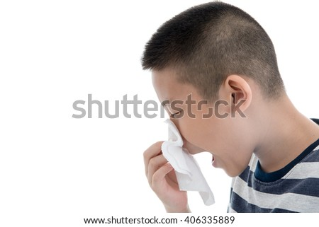 Flu cold or allergy symptom.Sick young asian boy with fever sneezing in tissue,allergies,the common cold,with blank copy space on white