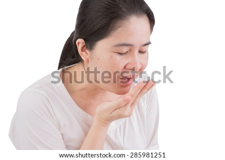 Flu cold or allergy symptom. Sick young woman girl sneezing in tissue isolate on white background. Health care. Studio shot. - stock photo