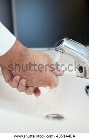 Flu/disease prevention - Washing hands thoroughly with running water and soap - stock photo