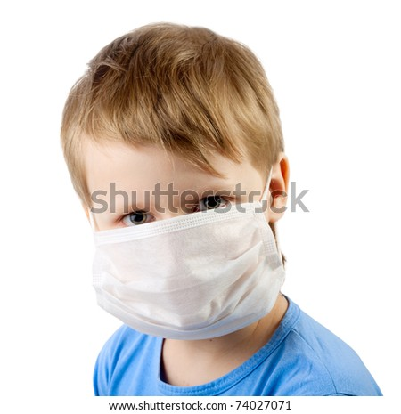 Flu illness child boy in medicine healthcare surgical mask isolated over white background