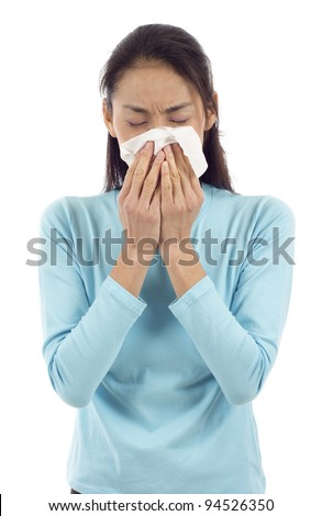 Flu or cold - sneezing woman sick blowing nose isolated over white background - stock photo