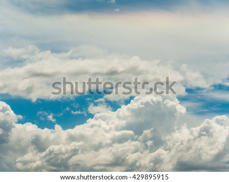 Fluffy bright clouds on the blue sky in daytime. - stock photo