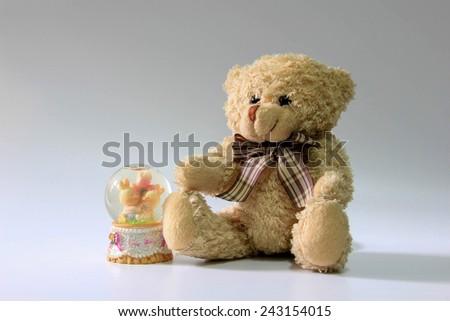 Fluffy brown teddy bear sitting down - stock photo