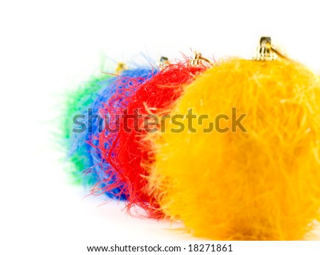 Fluffy christmas baubles on white background, focus on red bauble