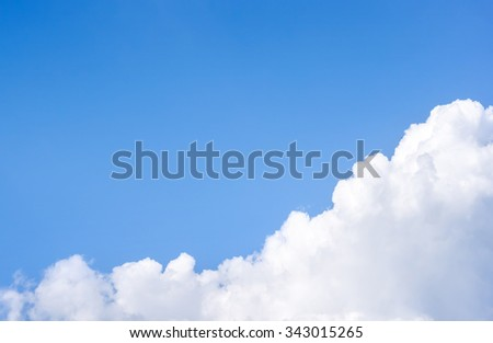 fluffy clouds and clear sky