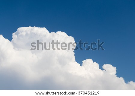 Fluffy clouds in the sky - stock photo