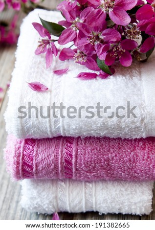 Fluffy Cotton Spa Towels with Scent Flowers - stock photo