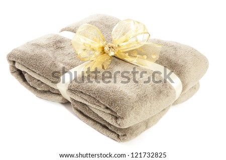 fluffy natural brown blanket with golden knot isolated over white - stock photo