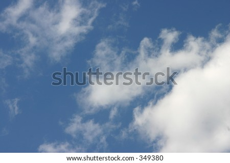Fluffy white clouds on a blue sky. A nice summer day. - stock photo