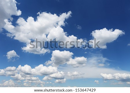 fluffy white clouds on blue sky in sunny summer day - stock photo