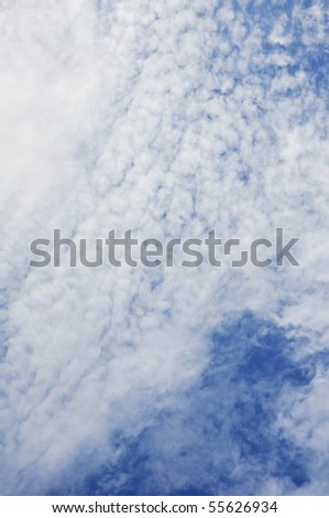 Fluffy white clouds shot from below - stock photo