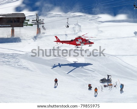 FLUMSERBERG, SWITZERLAND - MARCH 5: A rescue helicopter evacuas a skier after an accident in Flumserberg, Switzerland on March 5, 2011. Skiing safety becoming an issue on crowded slopes.