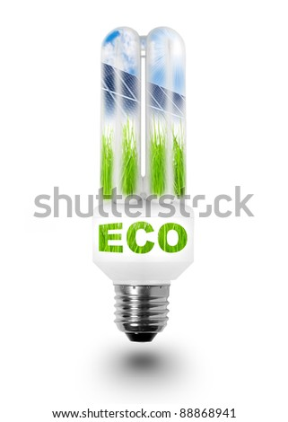 Fluorescent lamp bulb with solar panels on grass and green notice eco. Conceptual image. Environmental metaphor. - stock photo