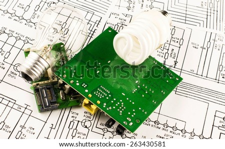 fluorescent lamp, incandescence and chip on the background drawings of microcircuits - stock photo