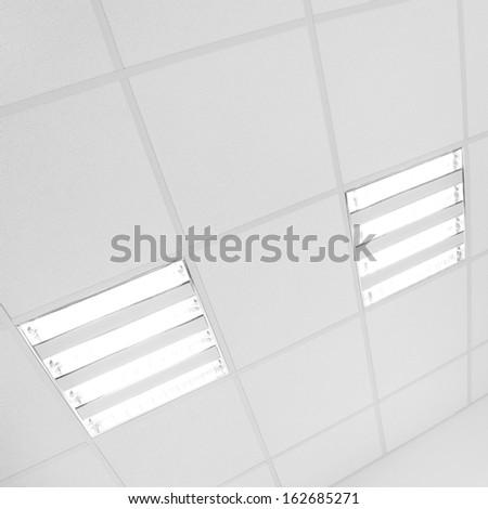fluorescent lamp light on the white modern ceiling - stock photo