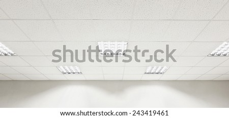 Fluorescent lamp on the modern ceiling and wall - stock photo