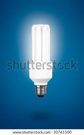 Fluorescent Light Bulb on a blue background ? energy concept - stock photo