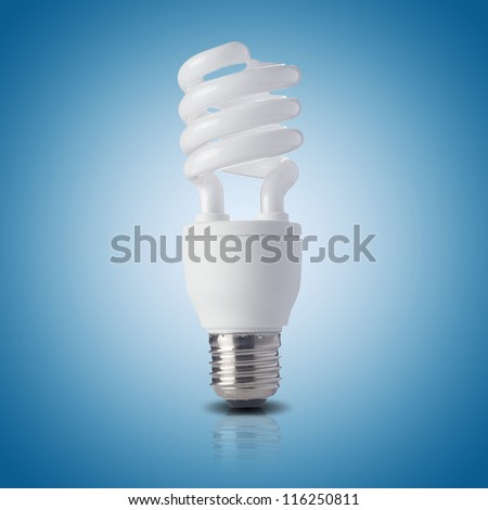 Fluorescent light bulb on blue background. Concept for energy conservation - stock photo