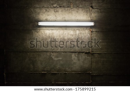 Fluorescent light tube on the wall - stock photo