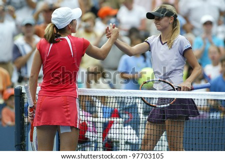 FLUSHING - AUGUST 30: Justine Henin-Hardenne of Belgium (L) shakes hands with Zuzana Ondraskova of the Czech Republic after defeating her at Arthur Ashe Stadium on August 30, 2005 in Flushing, NY. - stock photo