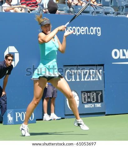 FLUSHING, NEW YORK- SEPT. 4: Maria Sharapova returns the ball in Arthur Ashe Stadium at the US Open, Sept. 4, 2010, Flushing, New York. - stock photo