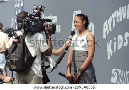 FLUSHING NY - AUGUST 28: Tennis player Alexandra Stevenson answers reporter questions at the Arthur Ashe Kids Day in Arthur Ashe Stadium August 28, 1999 in Flushing NY. - stock photo