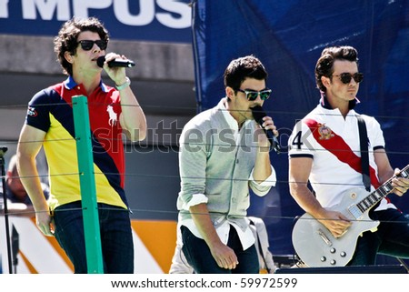 FLUSHING, NY - AUGUST 28: The Jonas Brothers perform at Arthur Ashe Kids' Day at the Billie Jean King National Tennis Center on August 28, 2010 in Flushing, New York. - stock photo