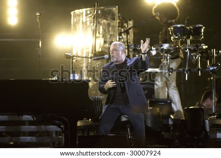 FLUSHING, NY - JULY 16: Singer Billy Joel gestures as he performs at Shea Stadium on July 16, 2008 in Flushing, New York. - stock photo