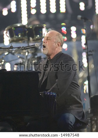 FLUSHING, NY - JULY 16: Singer Billy Joel performs at Shea Stadium on July 16, 2008 in Flushing, New York. - stock photo