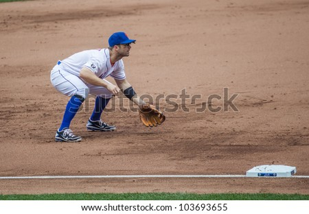 FLUSHING, NY - MAY 26: The NY Mets' David Wright plays third base in a game at Citi Field on May 26, 2012 in Flushing, NY. - stock photo
