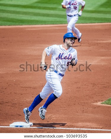 FLUSHING, NY - MAY 26: The NY Mets David Wright rounds third on his way to score in a game at Citi Field on May 26, 2012 in Flushing, NY. - stock photo
