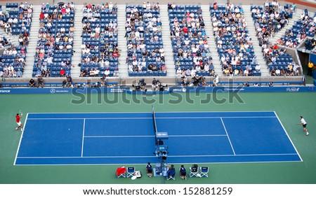 FLUSHING, NY-SEP 3: Novak Djokovic (SRB) (left) volleys the ball against Marcel Granollers (ESP) during round 4 of men's singles at the US Open on September 3, 2013 in Flushing, New York.  - stock photo